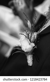 Beautiful groom boutonniere or buttonhole. Black and white photo
