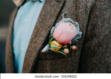 Beautiful groom boutonniere on his jacket