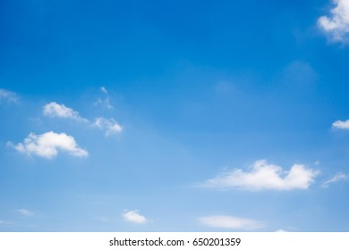 Beautiful a group of clouds in the blue sky during the sun shin background.