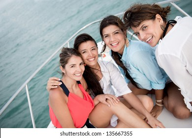 Beautiful group of girl friends in a boat having fun