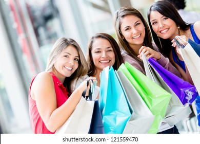 Beautiful group happy girls at the shopping center