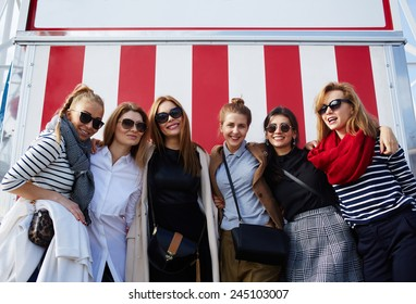 Beautiful group of smiling girls posing together and having fun at holidays