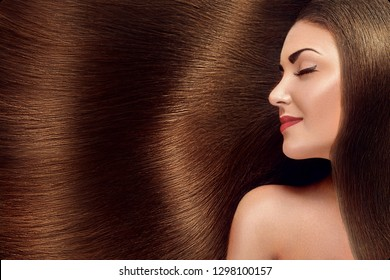 Beautiful Hair. Beauty woman with luxurious long hair as background. Beauty Model Girl with Healthy brown Hair. Pretty female with long smooth shiny straight hair. Hairstyle. Keratin straightening.