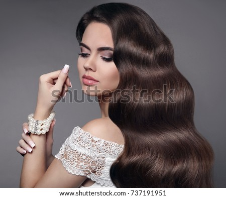 13b14fc6d1a Beautiful hair. Brunette girl portrait. Beauty makeup. Long healthy wavy  hair. Fashion
