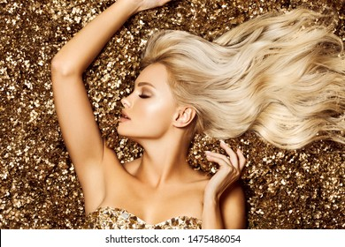 Beautiful hair Girl. Healthy Long Hair. Blonde woman in golden flowers garden, princes