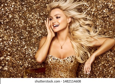 Beautiful hair Girl. Healthy Long Hair. Blonde smiling woman in golden flowers garden, princes