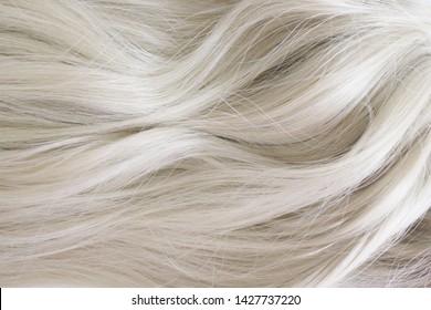 Beautiful hair. Long curly blonde hair. Color in light ash blonde.