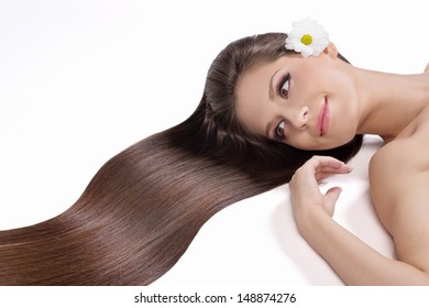 Beautiful hair. Top view of young women with beautiful hair smiling and looking away while isolated on white
