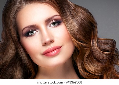 Beautiful hair woman beauty skin portrait over dark background. Long beautiful healthy hair model girl stock image.