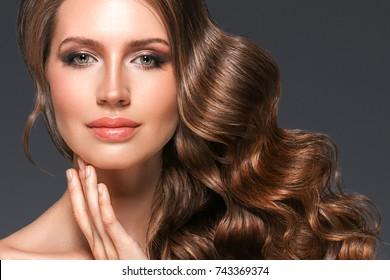Beautiful hair woman beauty skin portrait over dark background. Long beautiful healthy hair model girl stock image.