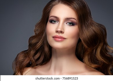 Beautiful hair woman beauty skin portrait over dark background. Long beautiful healthy hair model girl stock image. Studio shot.