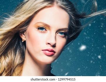 Beautiful hair woman blonde winter background snowflakes