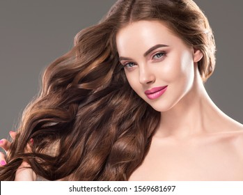 Beautiful hair woman fashion makeup face close up cosmetic concept