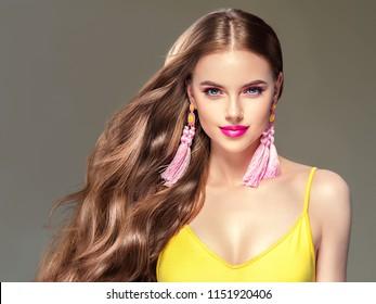 Beautiful hair woman long brunette hairstyle with earrings summer dress beauty face lips model
