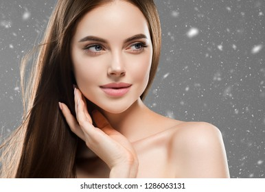 Beautiful hair woman long brunette hairstyle winter background snowflakes