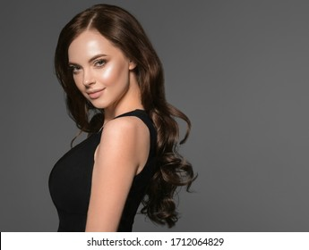 Beautiful hair woman long brunette natural beautiful hairstyle female over dark background
