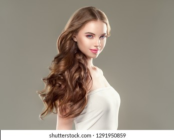 Beautiful hair woman long curly brunette hairstyle beauty healthy shampoo skin