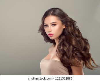 Beautiful hair woman with long healthy hairstyle beautiful skin makeup female cosmetic portrait