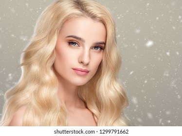 Beautiful hair woman winter background snowflakes