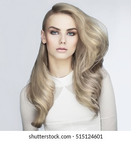 Beautiful haircut. Sexy woman with long hairs. Professional haircut.