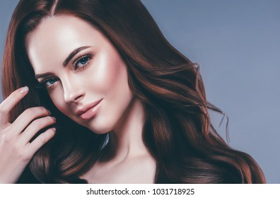 Beautiful hairstyle. Beauty woman close up portrait with healthy skin makeup and saloon hair long brunette