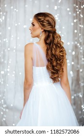 Beautiful Hairstyle of Bride in Lights. Fashion Dress and Coiffure. Close Up of Hairdo