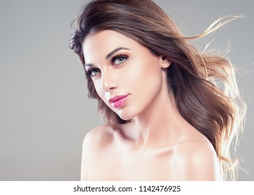 Beautiful hairstyle woman with brunette curly hair and beauty face over gray background female girl portraitgirl