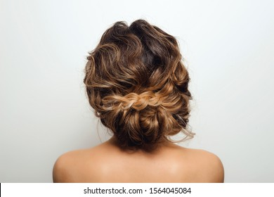 Beautiful Hairstyle of Woman. High Fashion Coiffure. Close Up of Hairdo