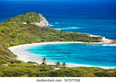 The beautiful Half Moon Bay in Antigua seen from above.