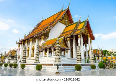 Beautiful hall of temple architecture of wat Suthat Thepphawararam with blue sky background in Bangkok of Thailand