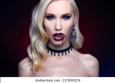 beautiful halloween make-up blond woman. vampire girl