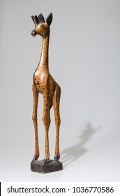 beautiful Hand carved wooden giraffe statue,  Wooden african giraffe ornament isolated in a white studio.
