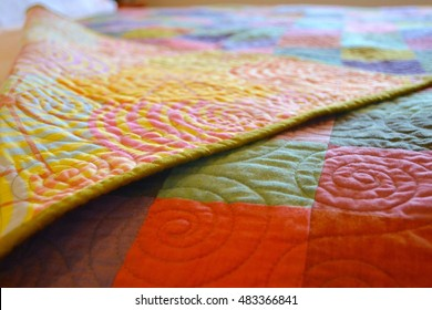 Beautiful hand crafted quilt in detail closeup throw on bed