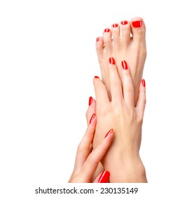 Beautiful hand and foot with red shiny manicure and pedicure, shellac. Concept of spa. Over white background with copy space.