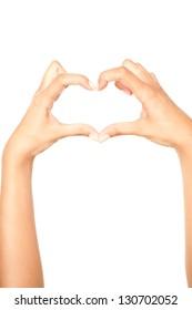 Beautiful Hand On White Making Heart Shape.