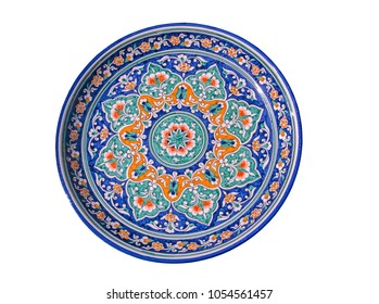 Beautiful hand painted blue ceramic dish with cotton ornament in Central Asian style. Isolated