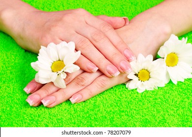 Beautiful hand with perfect nail french manicure  on towel background