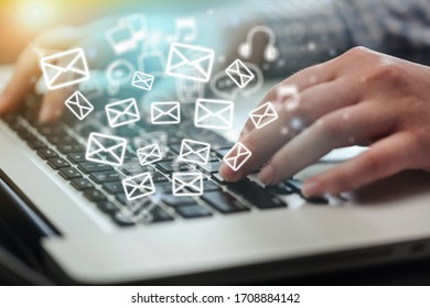 Beautiful hand working on a laptop with email icons