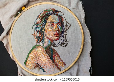 Beautiful handmade embroidery portrait of an asian woman