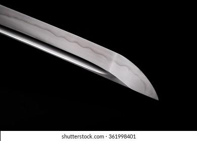 beautiful handmade katana sword on the black background