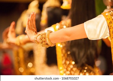 Beautiful hands of Khmer Apsara dance depicting the Ramayana epic, bright golden glittering in the backgrounds, the show is open to the public in Phnom Penh City, Cambodia.