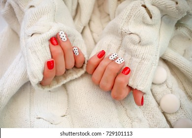 Beautiful hands with manicure in a white sweater.Natural nails, gel polish. Nail art design for the fashion style.