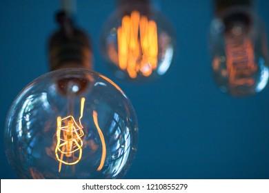 Beautiful hanged orange decoration light bulbs focus on pear shape like one in the coffee shop
