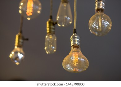 Beautiful hanged orange decoration light bulbs focus on pear shape like one in the coffee shop
