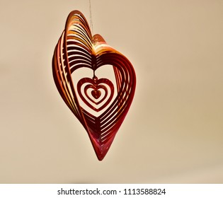 Beautiful hanging heart shape plastic showpiece object isolated unique photo