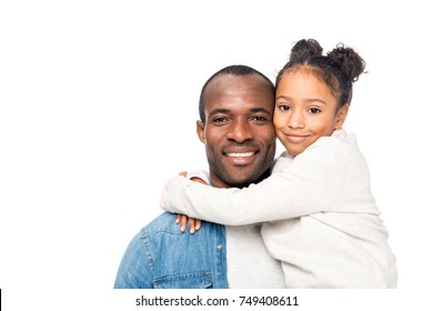 beautiful happy african american father and daughter hugging and smiling at camera isolated on white