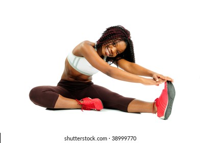 Beautiful Happy African American Woman Dressed For Fitness At The Gym Stretching Before Exercising