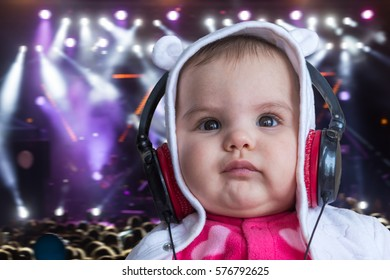 Beautiful Happy Baby Headphones Listening Music Stock Photo