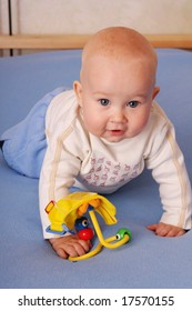 The beautiful happy baby plays with toys 3