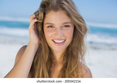 Beautiful happy blonde on the beach on a sunny day